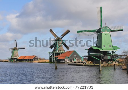 Typical dutch houses and windmills, Amsterdam - stock photo
