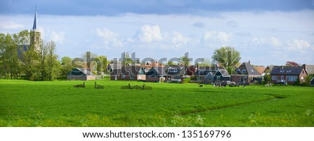 Typical dutch landscape in springtime in the Netherlands. Panorama - stock photo