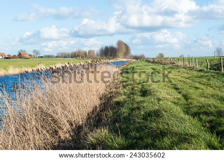 Typical Dutch rural landscape on a clear and sunny day in the winter season. - stock photo