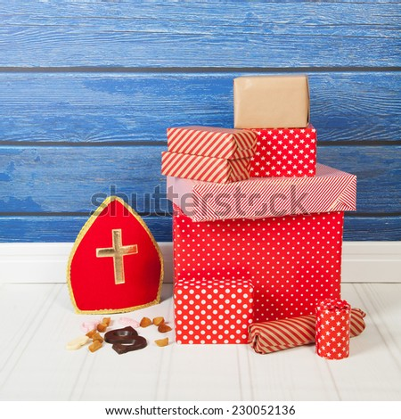 Typical Dutch Sinterklaas holidays with gifts, mitre and letter - stock photo