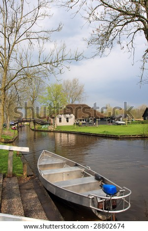 typical dutch village beside river