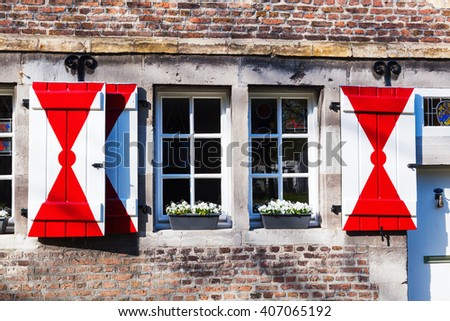 typical Dutch window at an old stone building in Maastricht, The Netherlands - stock photo