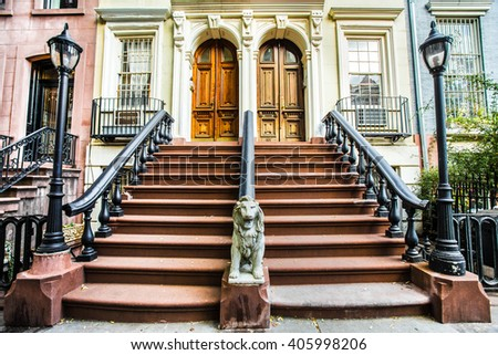 Typical exterior steps and doors on residential homes in the Chelsea district in New York City   - stock photo