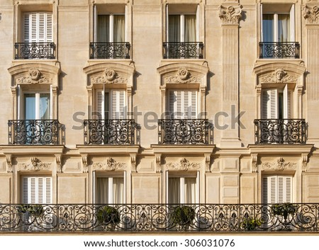 Typical facade of Parisian building near Notre-Dame - stock photo