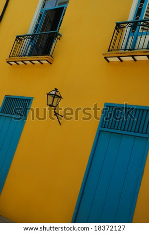 Typical facade with doors and windows in Old Havana building - stock photo