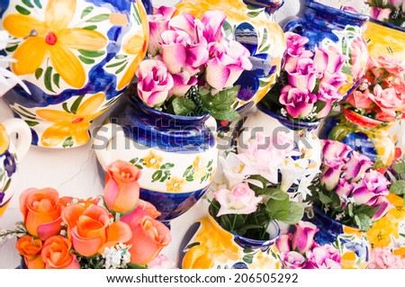 typical flower pots in a street - stock photo
