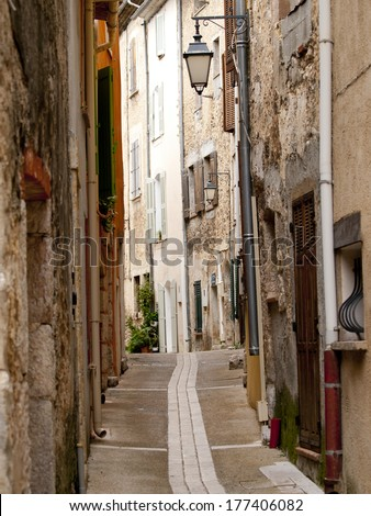Typical French alley in a small village - stock photo
