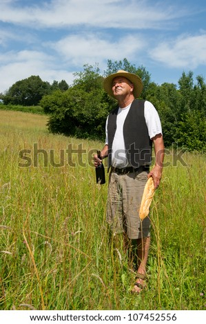 Typical French man in nature with bread and wine