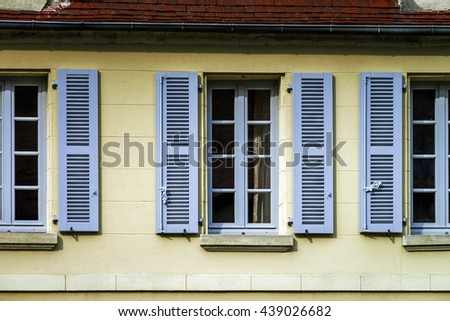 Typical french windows with wooden shutters, Paris region - stock photo