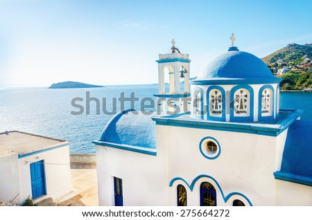 Typical Greek blue dome of white church with sea view in sunny day , Greece - stock photo