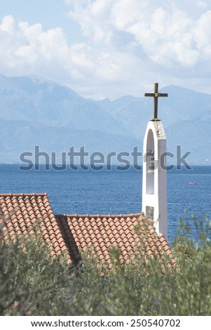 Typical Greek church. Sea on the background. Greece - stock photo