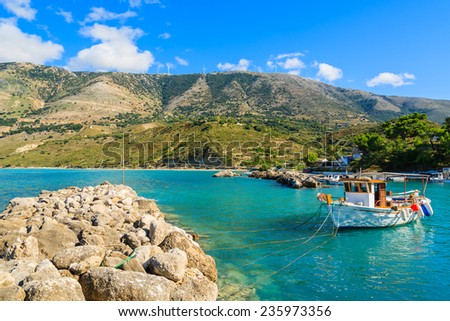 Typical Greek fishing boats in sea bay against mountains in Zola port, Kefalonia island, Greece - stock photo