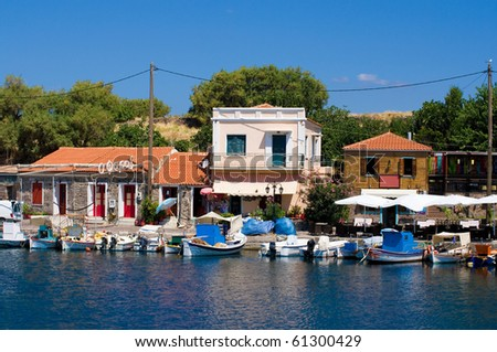 typical greek fishing harbor in the town of molyvos, lesvos, greece - stock photo