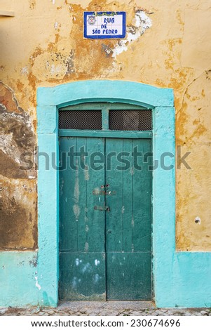 Typical green doorway in the old town of Olhao, Algarve, Portugal, Europe - stock photo
