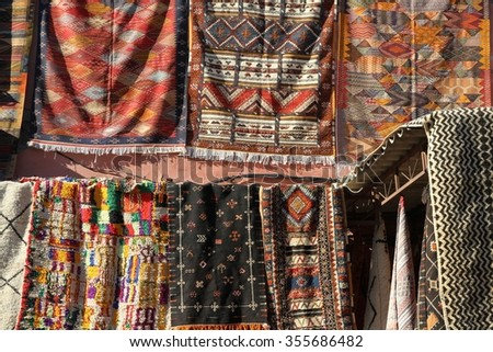 Typical hand woven Berber rugs for sale in the souks of Marrakesh, Morocco. - stock photo