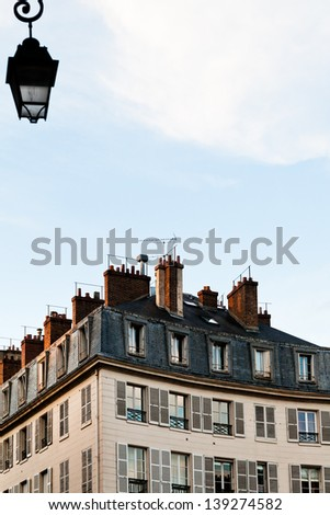 typical house in Paris in spring early evening - stock photo