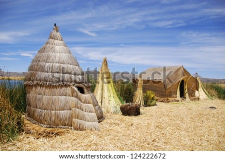 Typical house on Titicaca lake Peru. The dense root that the plants develop and interweave form a natural layer called Khili about one to two meters thick that support the islands - stock photo