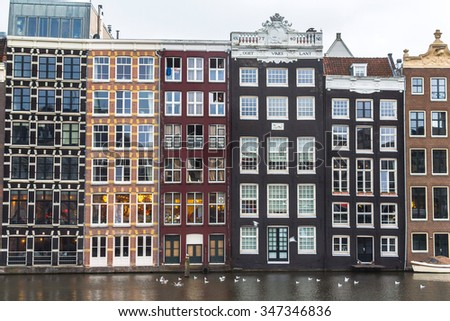 Typical houses on river in Amsterdam, Netherlands