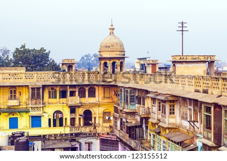 typical houses with roof life in early morning light in old Delhi, India - stock photo