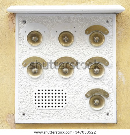 Typical intercom doorbell panel located on a yellow wall in Venice, Italy - stock photo
