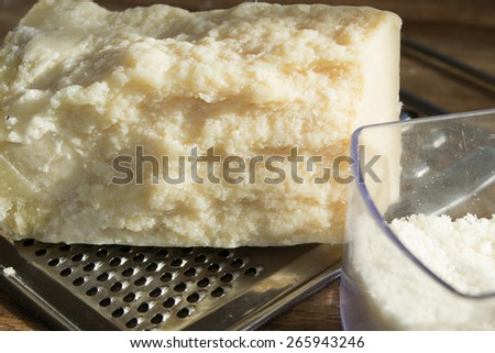typical italian cheese: parmesan to grate - stock photo