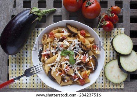 "typical italian food: sicilian pasta, called ""Norma"", with tomato, aubergines and ricotta cheese. Pasta alla norma. - stock photo"