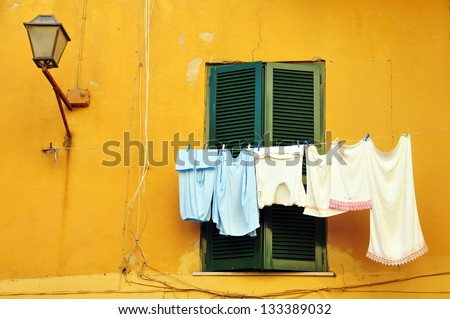 Typical Italian house with washing hanging on a line
