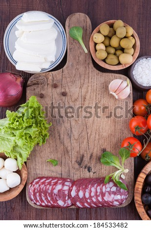 Typical Italian products on wooden board - stock photo