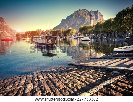 Typical italian village in the mountains. Italian village in Lecco Lake. Tower in Town Square in Lecco, Lombardy, Italy - stock photo