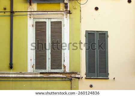 Typical Italian windows in old house  - stock photo