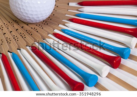 Typical Japanese hand fan made of bamboo and golf equipments
