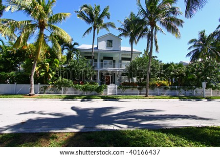 Typical Key West, Florida house surrounded by palm trees. - stock photo