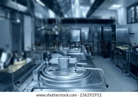 Typical kitchen of a restaurant, no people, toned, complex blur - stock photo
