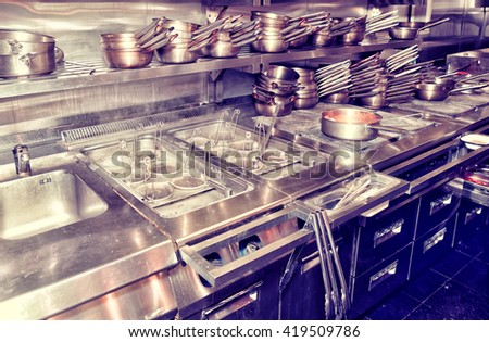 Typical kitchen of a restaurant shot in operation, toned image