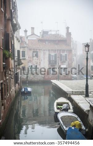typical little venetian romantic canal in the mist, Venice, near Scuola Grande di San Roccoand Rio de San Pantalon, Italy - stock photo