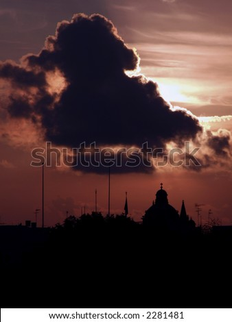 Typical Mediterranean cloudy sunset over Malta coastline - stock photo