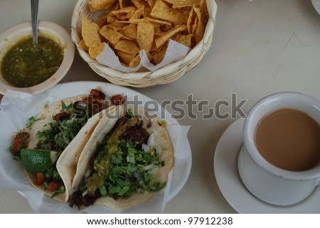 Typical Mexican food served at a South Austin Mexican restaurant includes taco al Pastor, taco de Barbacoa Coffee chips and hot salsa during SXSW 2012.