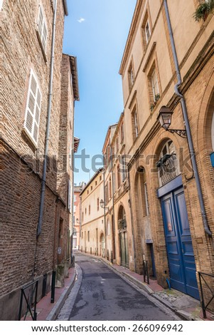 Typical narrow street in the inner city of Toulouse in France