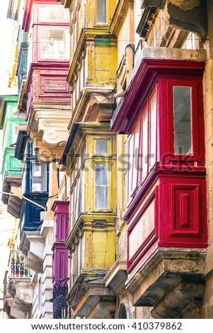 Typical narrow streets with colorful balconies in Valletta , Malta - stock photo