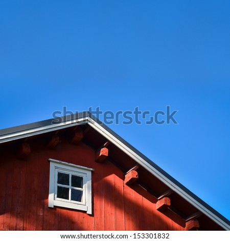 Typical norwegian red fishing hut with roof background - stock photo