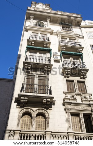 Typical old classical architecture in the center of Buenos Aires against a blue sky. Argentina 2014 - stock photo