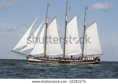 Typical old Dutch three mast sailing boat on sea - stock photo