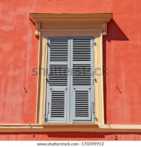 typical old grey french shutter window in red house of Nice, Cote d'azur, France. Square shape image  - stock photo