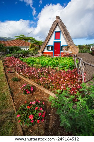 Typical old houses in Santana, Madeira, Portugal - stock photo