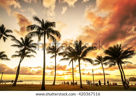 Typical picturesque sunset along Waikiki Beach at golden hour - stock photo
