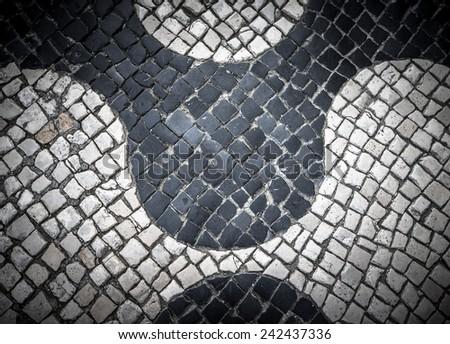 "Typical Portuguese black and white stone mosaic ""calcada"" pavement - found throughout Portugal - Cascais, Lisbon, Guimaraes - stock photo"