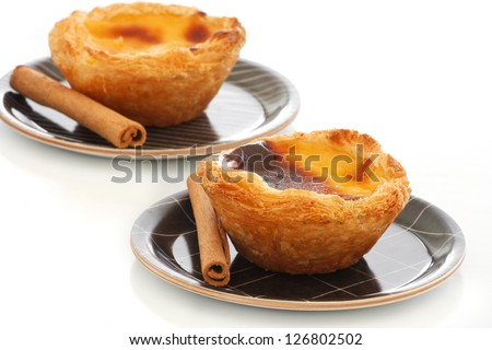 "Typical Portuguese custard pies (""Pastel de Nata"" or ""Pastel de Belem""). - stock photo"