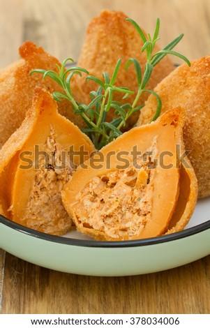 typical portuguese dish coxinhas de frango on plate - stock photo