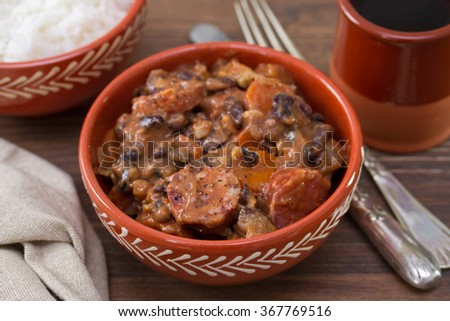 typical portuguese dish feijoada in ceramic bowl