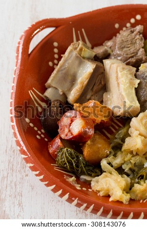 typical portuguese dish on ceramic plate on wooden background - stock photo